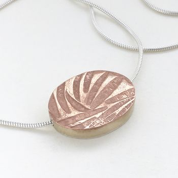 large embossed mixed metal reversible pendant