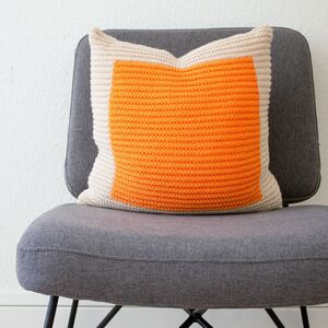 Hand Knit Colour Block Cushion In Ecru And Orange