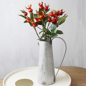 Artificial Red Rosehip Stems In A Jug