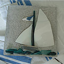 White sail boat tile.