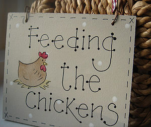 ' Feeding the chickens' Sign