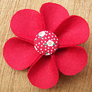 red flower and button brooch