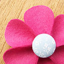 fuchsia button flower detail