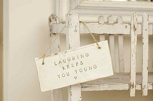 Laughing Keeps You Young Sign