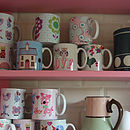 Mugs on shelf close up