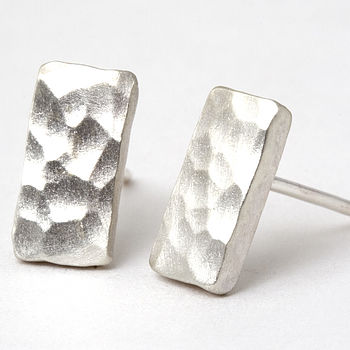 Chunky hammered studs with a matt satinised finish