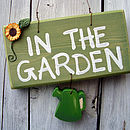garden sign_green can with sunflower
