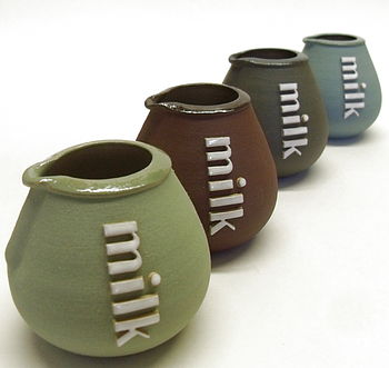 milk jugs. green, plum, slate, blue
