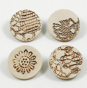 Lace impressed brooches in brown
