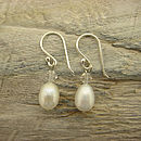 Pearl and crystal earrings on wood background 600