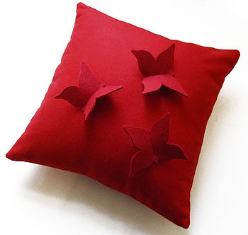 Dark red butterfly cushion