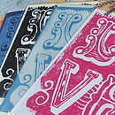 'Love' Handmade Linoprint Cards shown in a range of bespoke colours