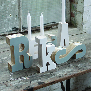 Alphabet candlesticks painted white and grey