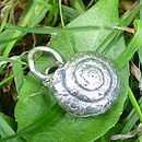 Snail charm on grass
