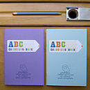 Abc colouring books on desk