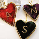 red, purple and green velvet hearts