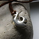 Sterling Silver Maori pendant on faux suede
