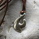 Maori Fish Hook Necklace on faux suede