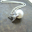 Silver pearl and bird necklace