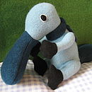 Light blue duck billed platypus with petrol blue scarf