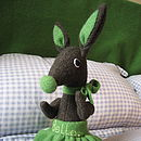 Brown rabbit with green skirt