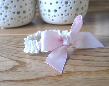 Baby wristband with pink satin bow