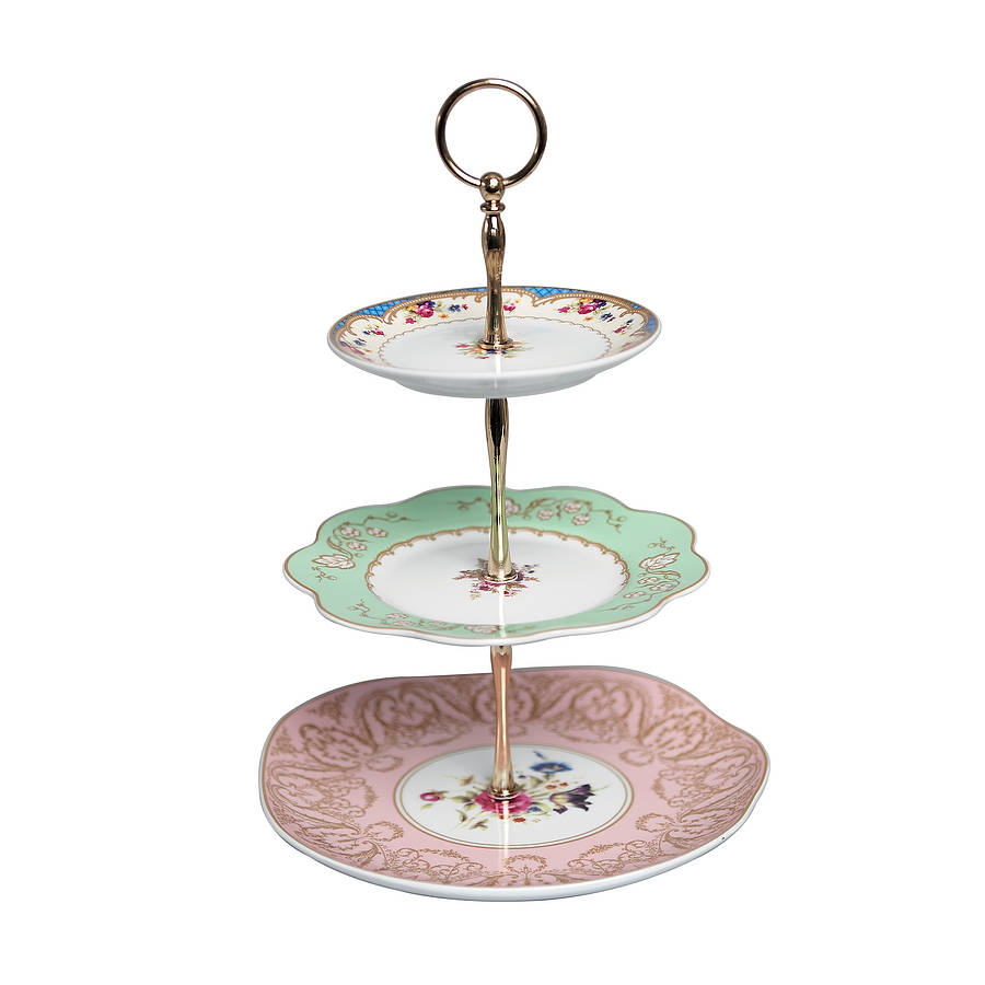 This round cake stand made of stainless steel This round cake stand made of stainless steel features a dais-style round tray with a smooth top and side and braided rope details on its rim offering convenient storage or display options for homes and living spaces. Its .
