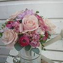 Flowers In A Watering Can