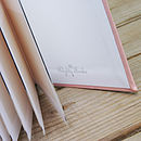 Inside back cover in Baby Pink Pastels with silver Logo Detail