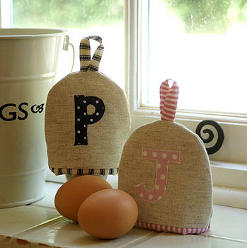 Egg cosies in navy and pink