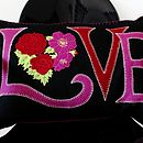 large black and pink love cushion