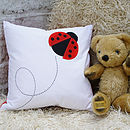 Thumb creature cushion   ladybird