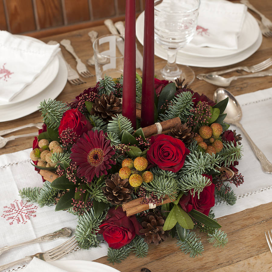 Christmas fresh fir and flower centrepiece by the