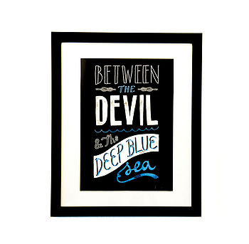 Between The Devil…Framed Print