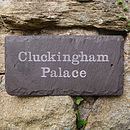 Two holes drilled in the sides 'Cluckingham Palace'