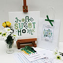 Contents of Green Daisy kit with finished sampler