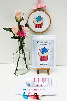"contents of CupCake Starter kit with finished cross stitch in 4"" hoop"