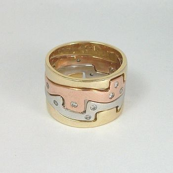 Gold Four Piece Jigsaw Ring With Diamonds