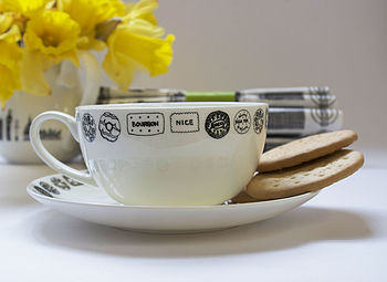 Illustrated Biscuit Tea Cup And Saucer