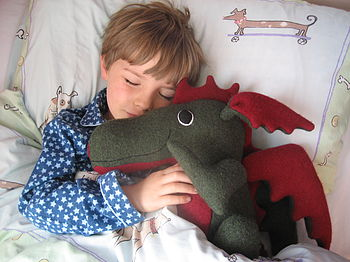 Sleeping boy with dragon
