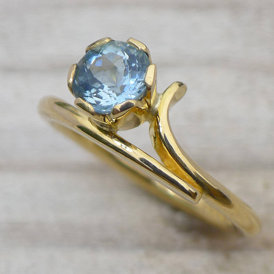 aquamarine ring in ethical 18ct yellow gold by lilia nash