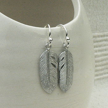 feather earrings: silver