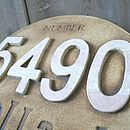 Detail of large sign with candy striped numbers
