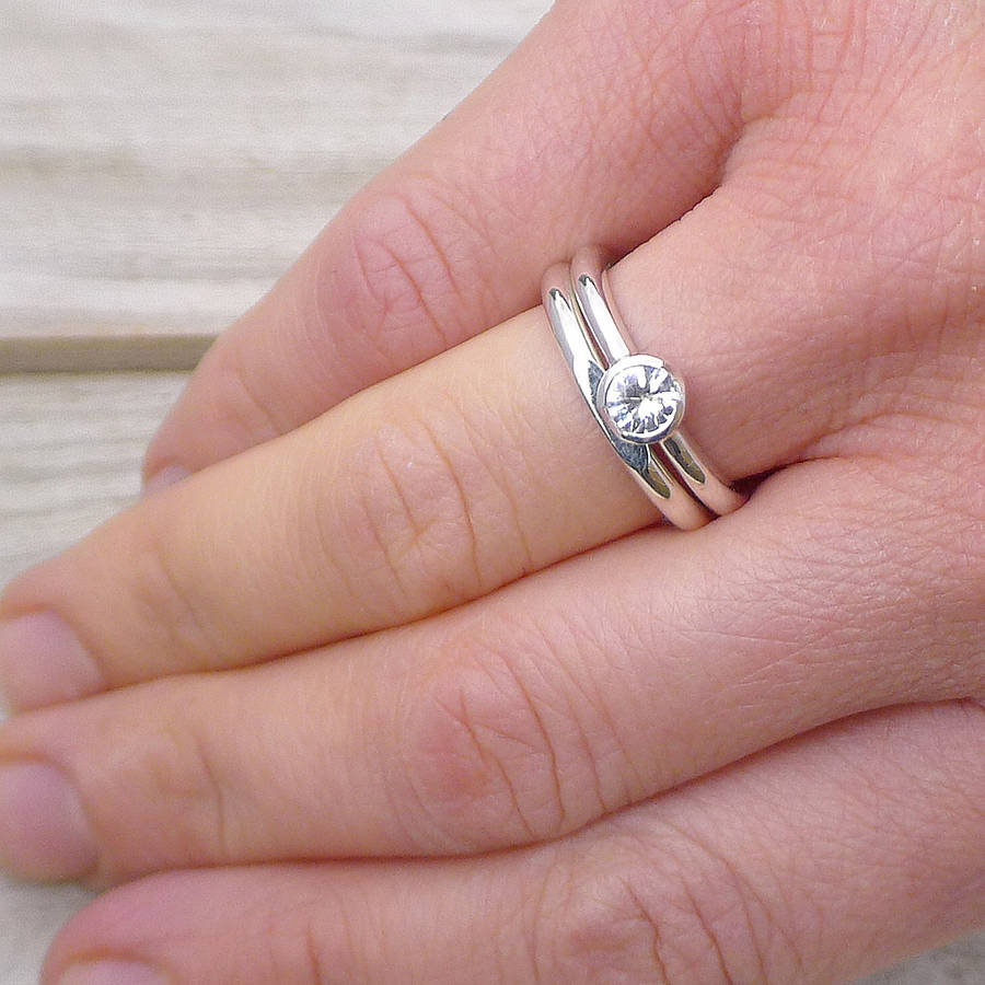 white sapphire engagement ring set by lilia nash jewellery