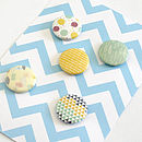 Set Of Five Patterned Badges