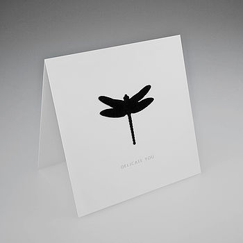 Black Flock Dragonfly Icon on White