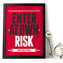 Personalised 'Enter at own Risk' print: black & white text on a red background