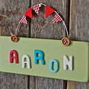Green wooden button door plaque