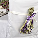 Wheat and lavender bundle being used as a chair back (extra ribbon has been added)