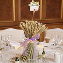medium lavender wheat sheaf being used as a table center piece